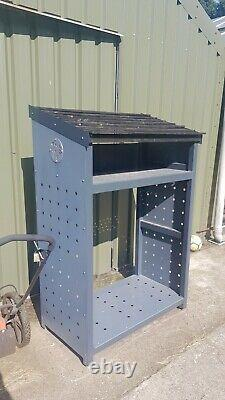 Metal and wood log store. For wood logs & kindling. For outside, shed or garage